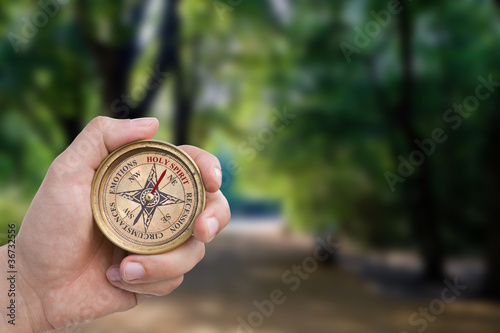 Male Hand Holding Christian Compass