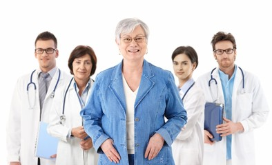 Senior patient in front of medical team