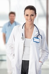 Female doctor standing with hands in pocket