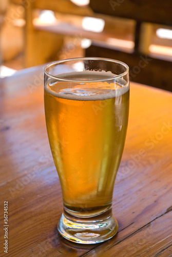 beer in the glass on the table