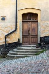 Doorway on a cobblestone street.