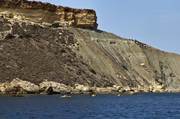 Malta Island, young people on kayaks in Gnejna Bay