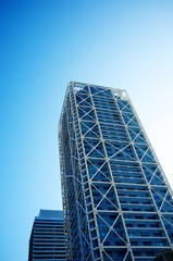 Skyscrapers over blue sky.