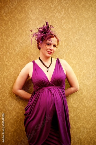 Beautiful redhead woman in purple dress.