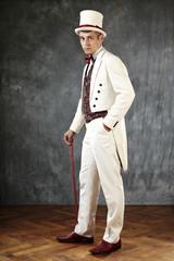 Posing man in tail coat