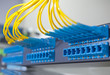 shot of network cables and servers in a technology data center .