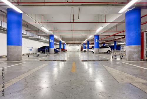 Parking garage, underground interior with a few parked cars - 36753381