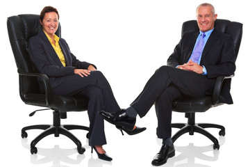 Mature business people sat in chairs