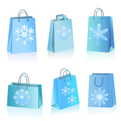 Blue paper bags with snowflakes icon