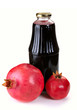 Bottle of juice and ripe pomegranate