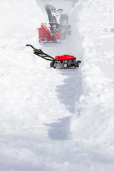 Snow Cleaning Machine Opening Way on Driveway