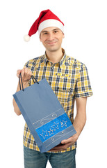 shopping man in christmas hat with paper bag