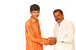 indian teenager shaking hands with old man