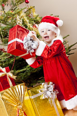 little girl as Santa Claus with Christmas presents