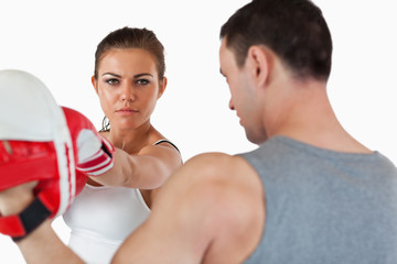 Confident looking female with her martial arts trainer