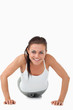 Smiling woman doing push ups