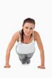 Atletic female doing push ups