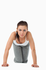 Young woman doing push ups