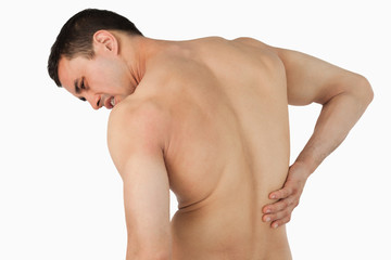 Back view of male suffering from back pain