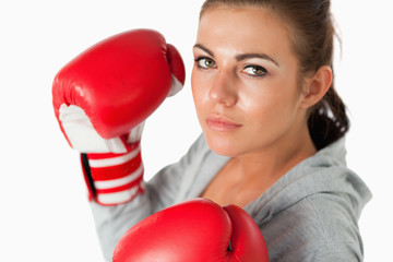 Cute woman with boxing gloves