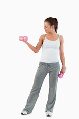 Portrait of a woman working out with dumbbells