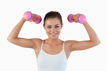 Sports woman working out with dumbbells