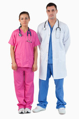 Portrait of serious doctors standing up