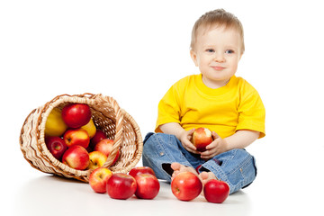 Child eating apple and basket