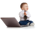 Child using a laptop and clapping his hands