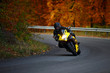 man riding with speedbike in autumn - 36771163