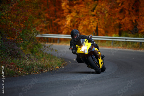 man riding with speedbike in autumn