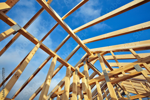 looking up to the roof structure in a modern timber-frame house