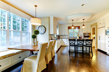 White large luxury modern kitchen and dining table