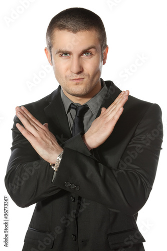 Young business man making enough gesture