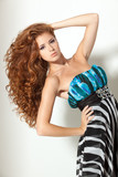 Beautiful red-haired fashion model posing