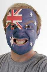 Face of crazy angry man painted in colors of australia flag