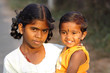 Indian teen girl with little boy.