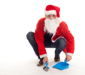 sweeping Christmas man with dustpan