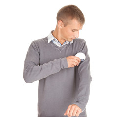 young man cleaning dust from grey sweater
