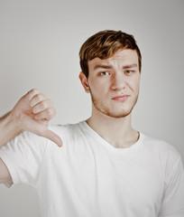 young man shows thumb down