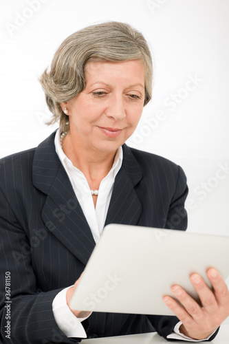 Senior businesswoman touch-screen tablet computer