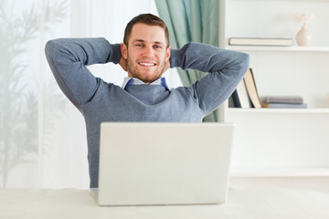 Smiling businessman leaning back