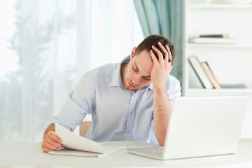 Businessman reading an alarming letter