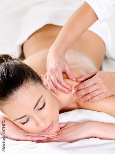 Beautiful woman having massage on shoulder