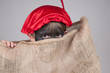 boy dressed up as zwarte Piet in a bag