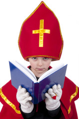 boy dressed up as Dutch Santa with book