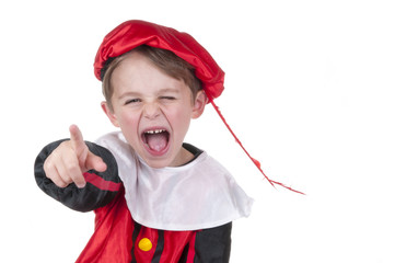 boy pointing and dressed up as Zwarte Piet