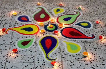 Beautiful colourful rangoli with deepak