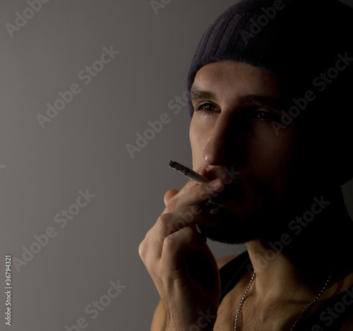 portrait of a young man with a cigarette
