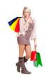 junge blonde Frau mit Einkaufstaschen